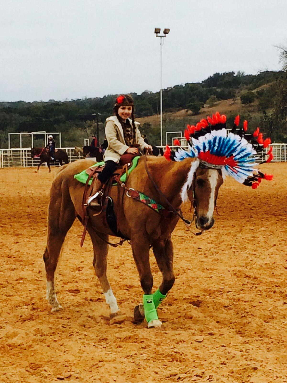 Check out Fiesta and his new five year old owner at her first play day.  This is the costume context.  Nov. 16, 2014